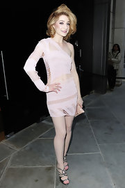 Nicola Roberts looked angelic in strappy silver sandals. The heels glimmered against her porcelain skin.