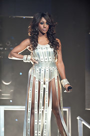 Alexandra performed in a metallic bodysuit with white trailing fringe.