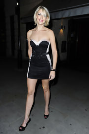 Ali Bastian paired her little black cocktail dress with a pair of platform peep toe pumps.
