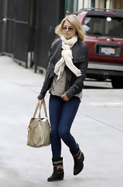 Ali Larter kept her look comfy in mid-calf flat boots complete with printed detailing.