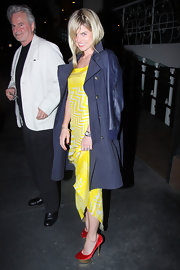 Alice Eve sported a bright yellow, zig-zag print dress while out with her family in Hollywood.