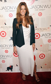 Kelly Bensimon dressed down her white gown with a black tuxedo style blazer.