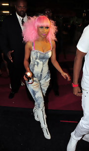 Nicki ditched her asymmetrical bob and rocked a curly fro and face framing blunt cut bangs.