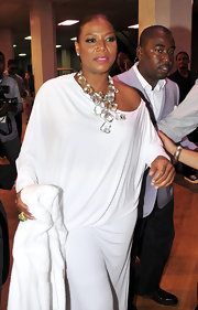 Queen Latifah showed showed off her crystal statement necklace, which worked nicely with her white off-the-shoulder dress.