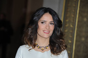 Salma Hayek attended the Stella McCartney fall 2012 fashion show in Paris wearing her ombre-colored tresses in tousled waves.