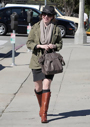 Alyson Hannigan stayed au courant in a pair of flat cognac riding boots, which she wore ove tall charcoal socks. She paired the boots with a military inspired jacket.