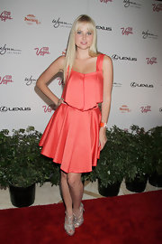 Genevieve Morton chose a pretty peach frock for her look at the 'Summer of Swim' event in Las Vegas.