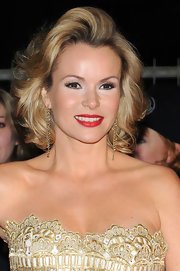 Long chain earrings played up Amanda Holden's strapless neckline.
