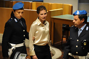 Amanda Knox appealed her case while wearing an ivory button down blouse and black slacks.
