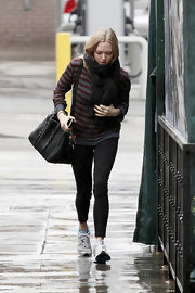 Amanda Seyfried clutched on to her stylish black leather tote as she made her way through the rain.
