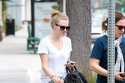 Amanda Seyfried drops off her dog Finn for some grooming at The Dog House in Los Angeles.