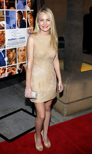 Britt Robertson dazzled in a gold cocktail dress featuring zigzag embellishments at the 'Mother and Child' premiere.