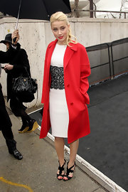 Amber Heard gave her ladylike sheath a fiery finish with a crimson coat and matching red lips.