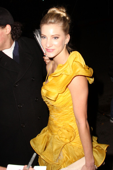 Actress Dianna Agron paired her yellow ruffled dress with a classic bun.