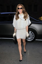 Jennifer Lopez toughened up her luxe winter white look with studded black Lucifer Bow stilettos.