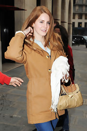 Lana Del Rey's camel raincoat complemented her rich auburn tresses.