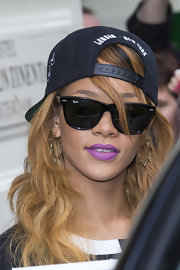 Rihanna looked hip and stylish in classic black Ray Ban wayfarers.