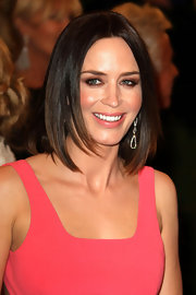Emily Blunt kept her look sleek and chic with this center-parted straight cut.