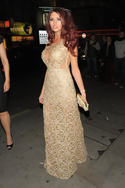 Amy Childs sported a flowing gold gown with mesh cutouts while out celebrating her birthday.