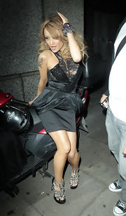 MySpace girl Tila Tequila sports several tattoos, including this winged heart with a musical note and two crossed guns.