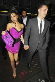 Amy paired her pink cocktail dress with a snakeskin clutch.