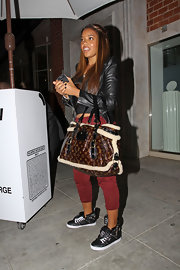 Angela Simmons finished off her casual threads with a monogrammed sheepskin tote.