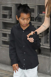 Maddox Jolie-Pitt looked serious in his black button-down shirt when he went to see the musical 'Wicked.'