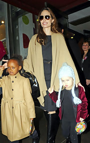 Angelina Jolie wore a thick gray day dress under her tan cape while out in NYC.