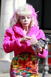Only Angelyne to get all dolled up in a hot-pink fur jacket just to go grocery shopping.