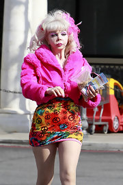 Angelyne channeled a 60s vibe with her psychedelic peace sign-print mini skirt.