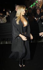 Kim Kardashian opted for edgy black peep-toe booties by Givenchy to finish off her ensemble.