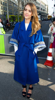 Jessica Alba opted for a fun and modern wool coat for her Paris Fashion Week look.
