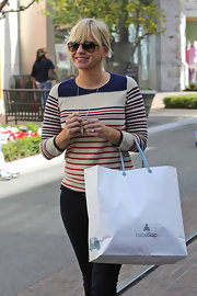 Anna Faris sported a preppy red, white and blue crewneck sweater while out shopping at the Baby Gap.