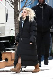 AnnaSophia Robb sure knew how to keep warm on set with this ankle-length down jacket.