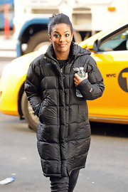 Freema Agyeman kept warm on the streets of NYC while filming 'The Carrie Diaries' in a long down jacket.