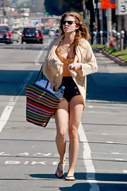 AnnaLynne McCord looked summery at the beach carrying a rainbow striped straw tote.