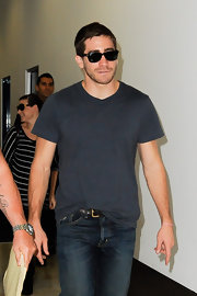 Jake looks super-cool in black Ray Bans and a casual tee.