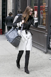 Anne Hathaway kept a low profile in NYC toting a gray leather duffel bag.