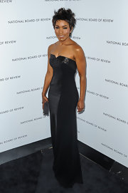 Angela looked sharp and glam in this strapless black evening dress with iridescent panels.