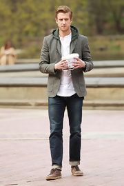 Arthur Darvill paired his casual ensemble with dark bootcut jeans cuffed at the bottom.