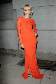 Natasha looked fiery in this embroidered gown at the Angel Ball.