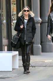 Ashlee Simpson broke out her fur messenger bag for a walk in New York City.