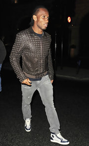 Didier Drogba paired a stylish patterned leather jacket with gray jeans for his team's victory celebration.
