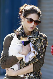 Ashley Greene left for work wearing her hair in a simple messy ponytail.