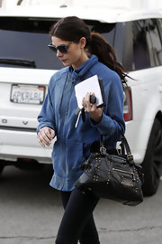 Ashley Greene toted a studded leather bag to a manicure appointment.