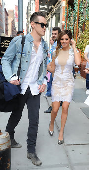 Ashley Tisdale stunned in a lace mini dress, featuring crystal detailed shoulders, while out with her boyfriend in NYC.