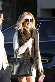 Ashley Tisdale accessorized her sweater dress with a thick brown scarf.
