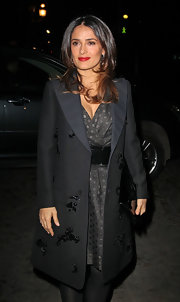 Salma Hayek kept her fashion week style sophisticated with a floral embellished evening coat.