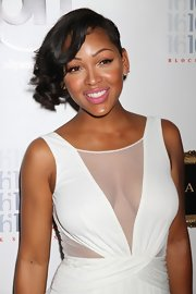 Meagan Good added bouncy curl to her edgy asymmetric cut to create a soft romantic look.