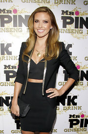 Audrina Patridge's gold touches—her circular pendant necklace and the sparkly lining of her blazer—made her outfit pop.